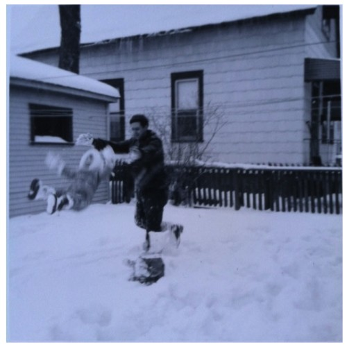 Maggie's father tossing her in the snow