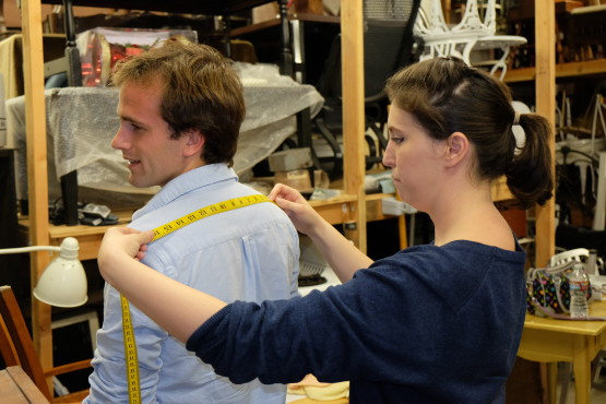 Jacinda measures actor Scott Nickley for costumes
